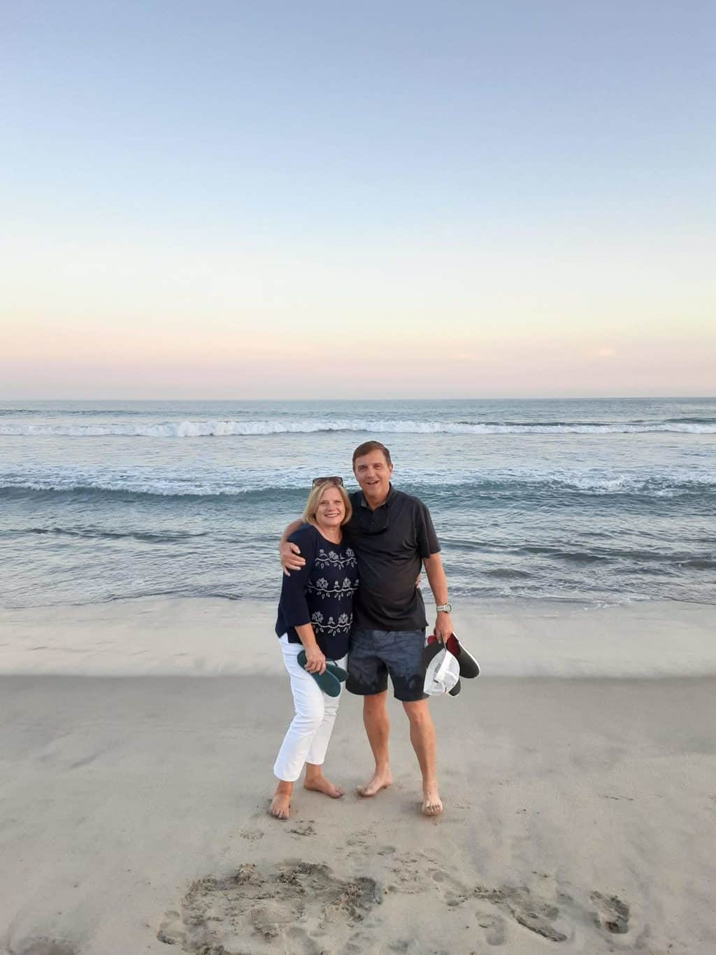 Rob and Lou Ann McMillen on the beach. They are SYMBIS facilitators.
