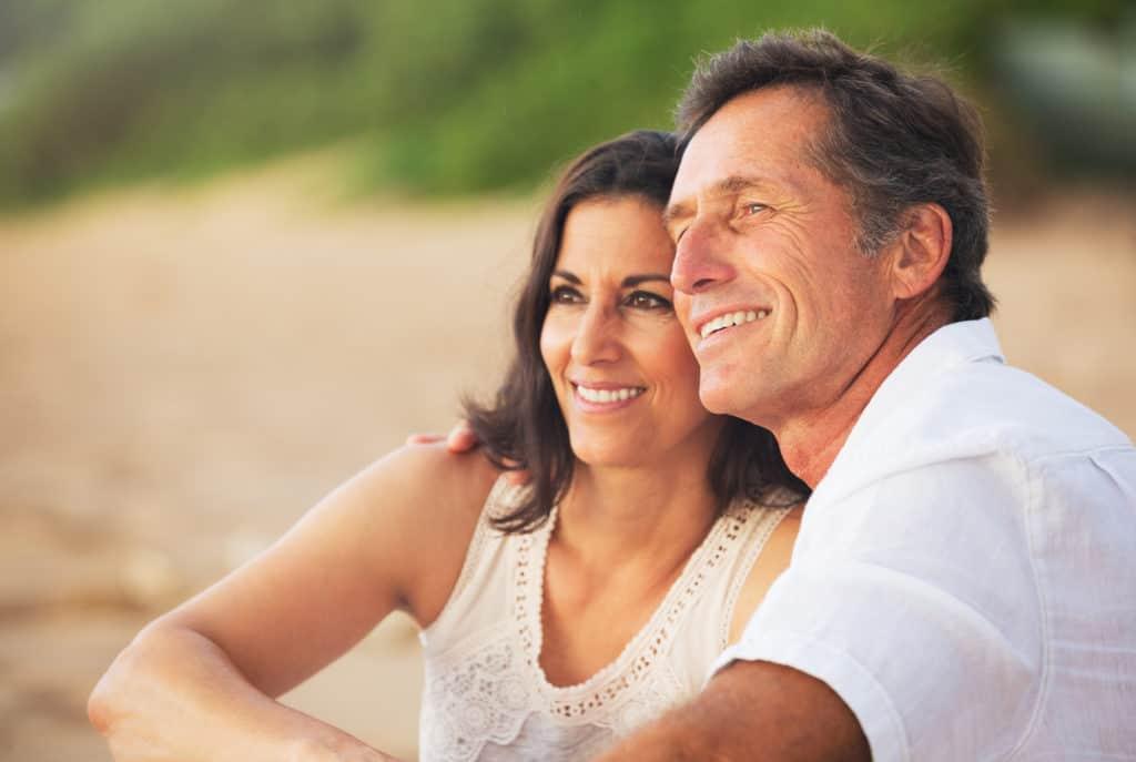 Older couple enjoying sunset marriage symbis